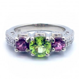 This is a picture of a 3 Stone Peridot and Pink Tourmaline Ring with Diamond Band