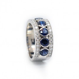This is a picture of a Blue Sapphire and Diamond Ring