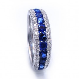 This is a picture of a Blue Sapphire and Diamond Ring in 18k White Gold