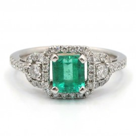 This is a picture of a Vintage Style Emerald Cut Emerald with Diamond Halo Ring