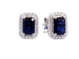 This is a picture of Emerald Cut Blue Sapphire Earrings with Diamond Halo
