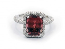 This is a picture of a Maroon Orange Tourmaline and Diamond Ring in Platinum