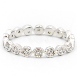 This is a picture of a Bezel Set Diamond Eternity Band set in 14k White Gold