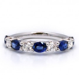 This is a picture of a Diamond and Blue Sapphire Alternating Eternity Band