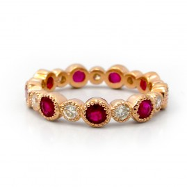 This is a picture of a Ruby and Diamond Band set in 14k Rose Gold