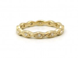This is a picture of a 14k Yellow Gold Marquise Outline Eternity Band