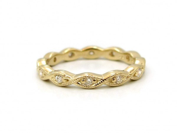 This is a picture of a 14k Yellow Gold Marquise Bezel Eternity Band