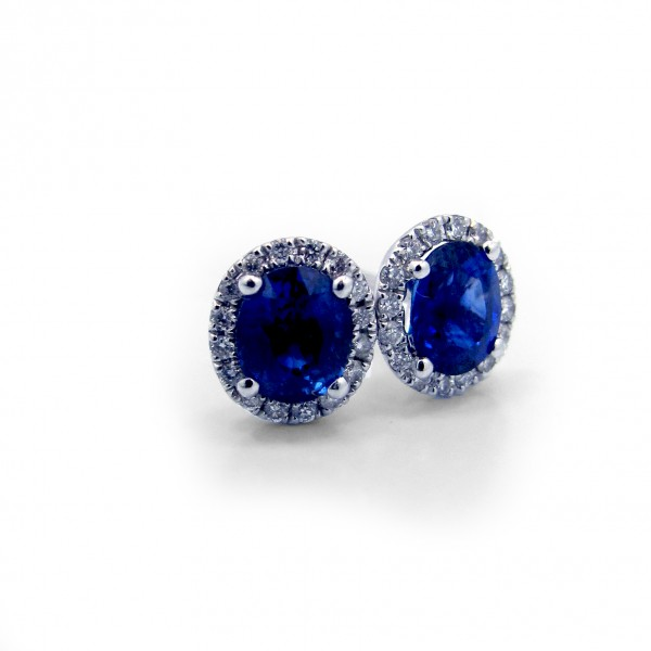This is a picture of Oval Blue Sapphire with Diamond Halo Stud Earrings