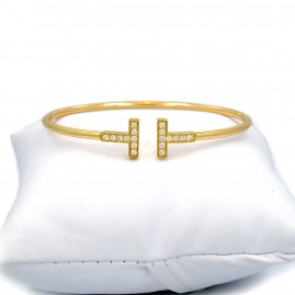 "This is a picture of an 18k Yellow Gold and Diamond Open ""T"" Bracelet"