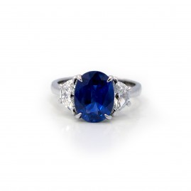 This is a picture of a 3 Stone Oval Blue Sapphire and Half Moon Diamond Ring