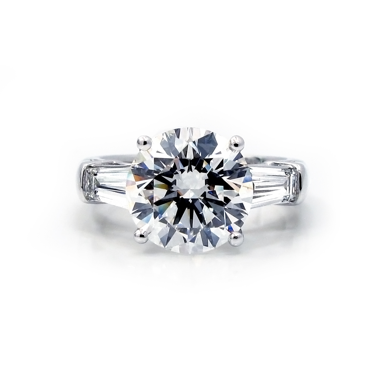 Engagement Ring With Round And Tapered Baguettes