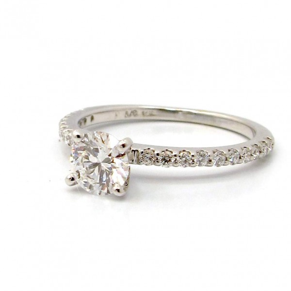 This is a picture of a 14K White Gold Four Prong Ring with Diamond Band