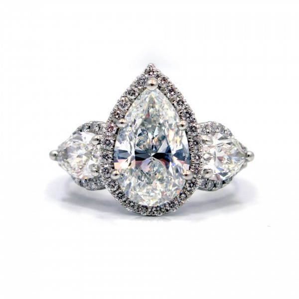 This is a picture of a Platinum Three Stone Pear with Halos Engagement Ring