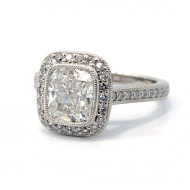 This is a picture of a Vintage Inspired Bead Set Bezel Halo with Milgrain Engagement Setting