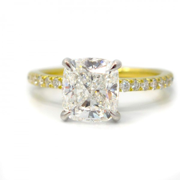 This is a picture of a 18k Yellow Gold Shared Prong Diamond Engagement Ring