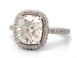 This is a picture of a Double Sided Halo and Diamond Band for Cushion Cut Diamond