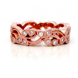 This is a 14k Rose Gold Diamond Floral Band