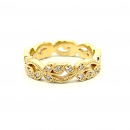 This is a picture of a 14k Yellow Gold Diamond Floral Style Band