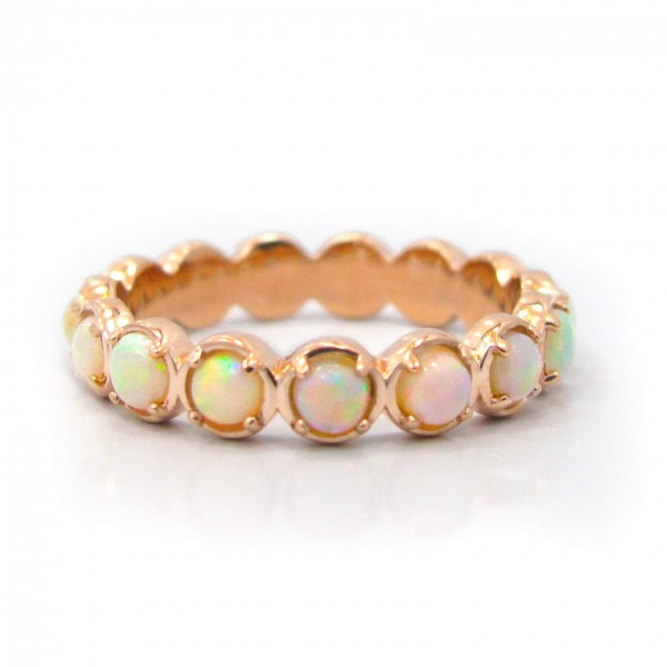 This is a picture of a 14k Rose Gold Opal Eternity Band