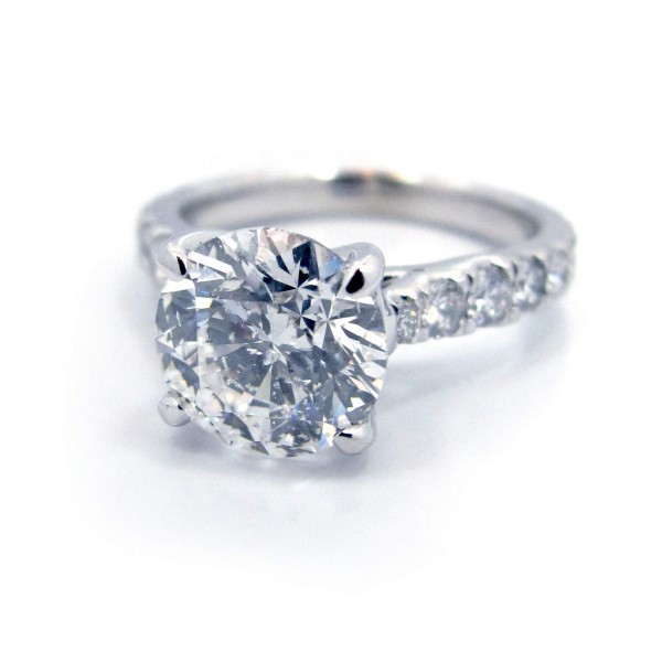 This is a White Gold Shared Prong Setting with 16 Graduated Diamond Band