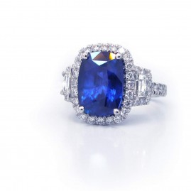 This is a picture of a Cushion Cut Blue Sapphire and Diamond Ring in Platinum