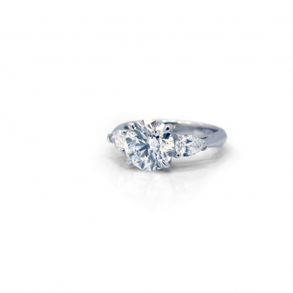 This is a picture of a Platinum Three Stone Setting with Two Pear Side Stones