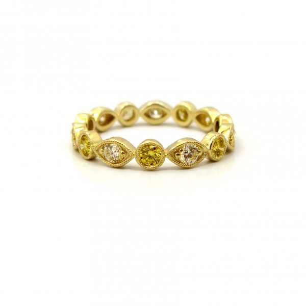 This is a picture of an Alternating Marquise and Round Bezel Fancy Yellow Diamond Eternity Band