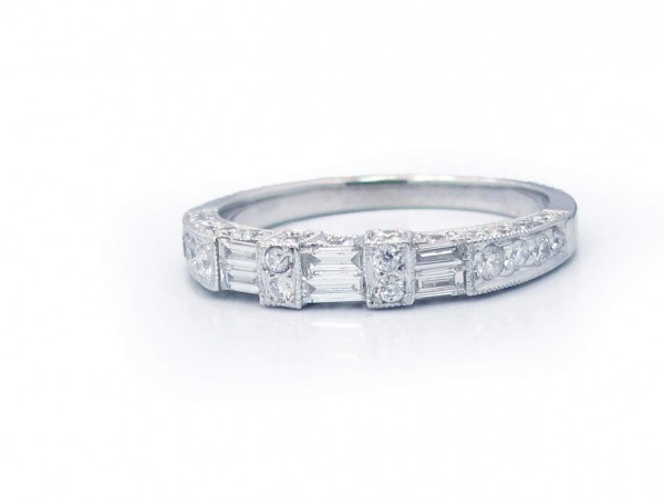 This is a picture of a Round Brilliant Diamond and Baguette Wedding Band