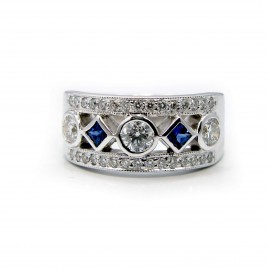 This is a picture of a 5 Stone Diamond and Princess Cut Blue Sapphire Ring