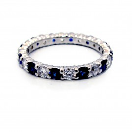This is a picture of an Alternating Diamond and Blue Sapphire Eternity Band