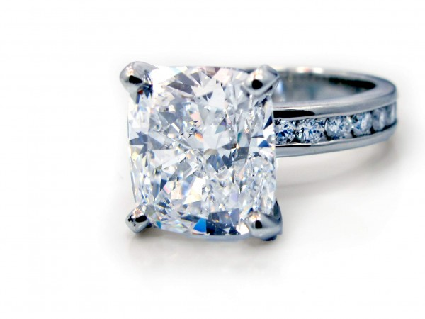 This is a picture of a Four Prong Platinum Channel Set Diamond Engagement Ring