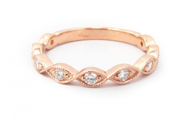This is a picture of a Round Diamond in Marquise Bezel Band in 14k Rose Gold