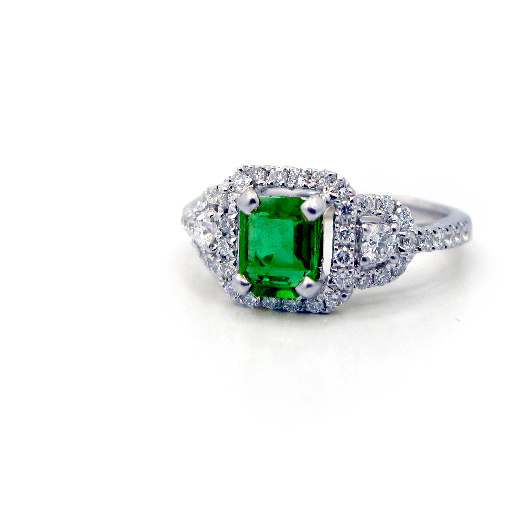 cut and product halo cocktail style vintage reuven with ring diamond emerald