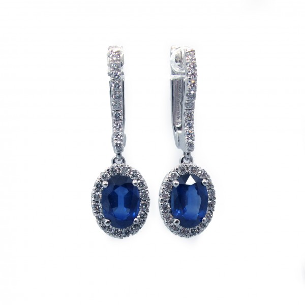 This is a picture of Oval Cut Blue Sapphire Earrings with Diamond Halo