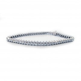 This is a picture of an 18K White Gold and Diamond Two Prong Tennis Bracelet
